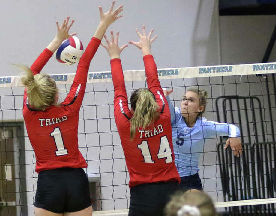 Jersey's Clare Breden (right) tools the block of Triad's Lauren McCurley and Kaity Colligan for a kill in the first set Thursday night at Havens Gym in Jerseyville. Photo: Greg Shashack | The Telegraph