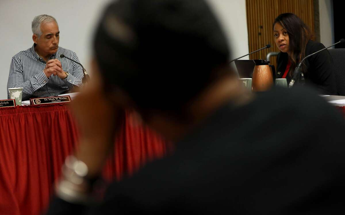 Dr. Mark W. Rocha (left), chancellor, listens as Shanell Williams, trustee, speak during the Board of Trustees meeting in Conlan Hall at City College San Francisco in San Francisco, Calif., on Thursday, September 26, 2019. Board members are supposed to figure out how to handle the executive raises being requested by Chancellor Rocha amid campus cuts.