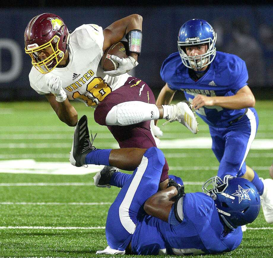 Beaumont United's Devin Hunt breaks ouit of thetackle by Baytown Sterling's defense at Stallworth Stadium Thursday. The game was United's first since Tropical Depression Imelda hit the area a week ago, damaging United, which remains closed while being repaired.  Photo taken Thursday, September 26, 2019 Kim Brent/The Enterprise Photo: Kim Brent / The Enterprise / BEN