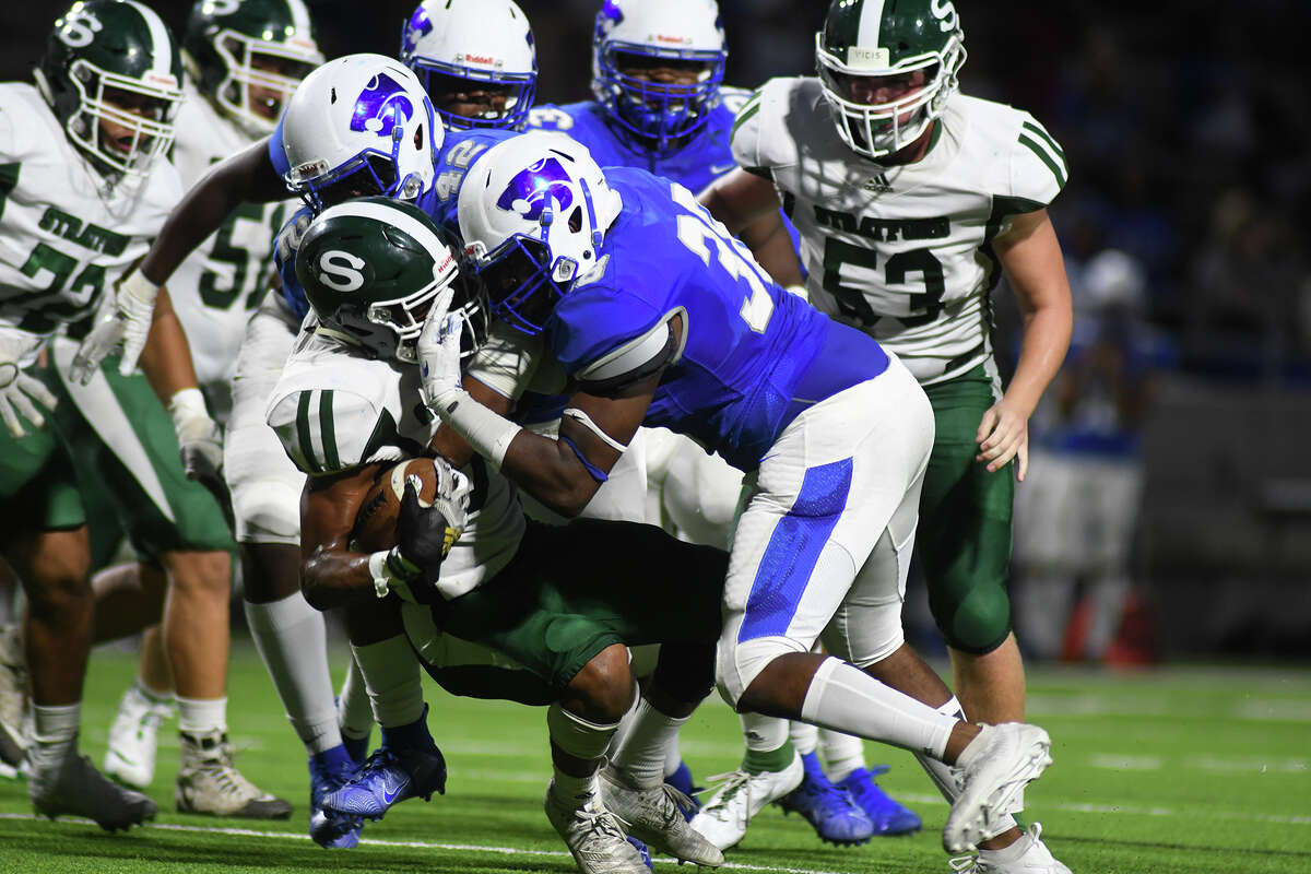 Cy Creek senior defensive end Byron Blassingame, right, stops Stratford junior running back Darese Steptoe, center, on a running play in the first quarter of their District 17-6A matchup at Pridgeon Stadium on Sept. 26, 2019.