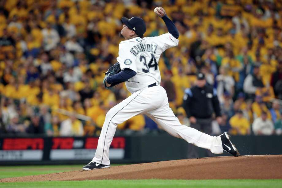 Seattle Mariners' Felix Hernandez pitches in the first inning of the Mariners game against the Oakland Athletics, Thursday, Sept. 26, 2019. Former Seattle Mariners great Felix Hernandez told 710 ESPN Seattle this week that he wants to reach 200 career wins and 3,000 strikeouts before he retires from baseball. Photo: Genna Martin, Seattlepi.com / GENNA MARTIN