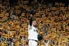 Seattle Mariners pitcher Felix Hernandez waves to fans as he takes the mound for what is likely his final start in their game against the Oakland Athletics, Thursday, Sept. 26, 2019.