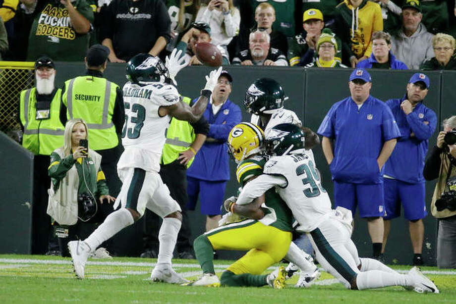 Philadelphia Eagles outside linebacker Nigel Bradham (53) intercepts a last minute pass to secure the victory against Green Bay Packers during an NFL football game Thursday, Sept. 26, 2019, in Green Bay, Wis. Philadelphia won 34-27. Craig James (39) is on the right. Photo: Associated Press