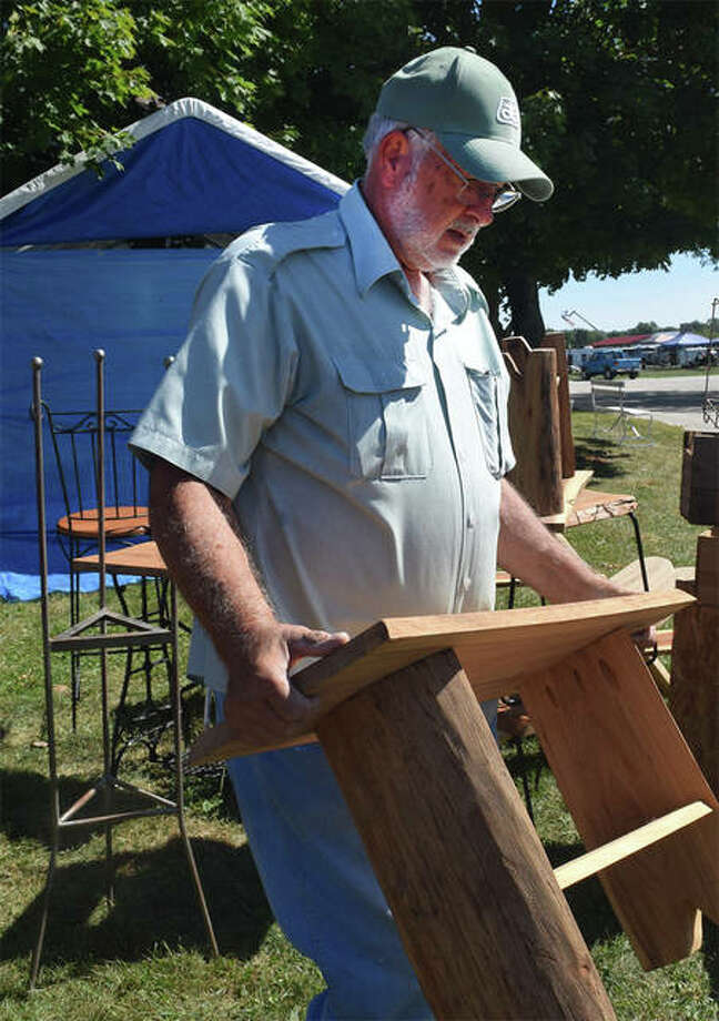 Don Crater of Ashland sets up his booth Thursday ahead of the 2019 Prairie Land Heritage Museum Institute's Fall Festival and Steam Show Days. The event, which is marking its 50th year, starts today and continues through Sunday on the museum grounds at Lincoln and Michigan avenues. Gates open at 7 a.m. daily. Photo: Samantha McDaniel-Ogletree | Journal-Courier