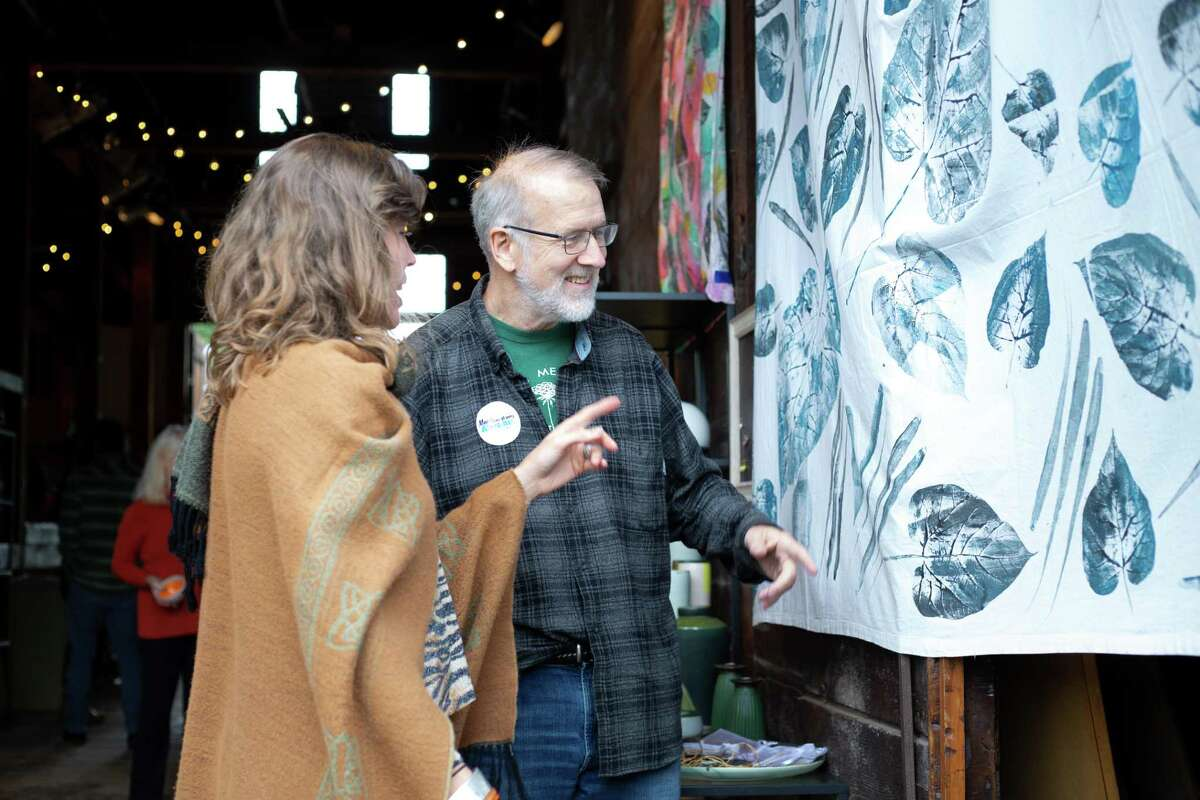 Visitors to the Eli Whitney Barn looking at the work of a City-Wide Open Studios artist in 2018.