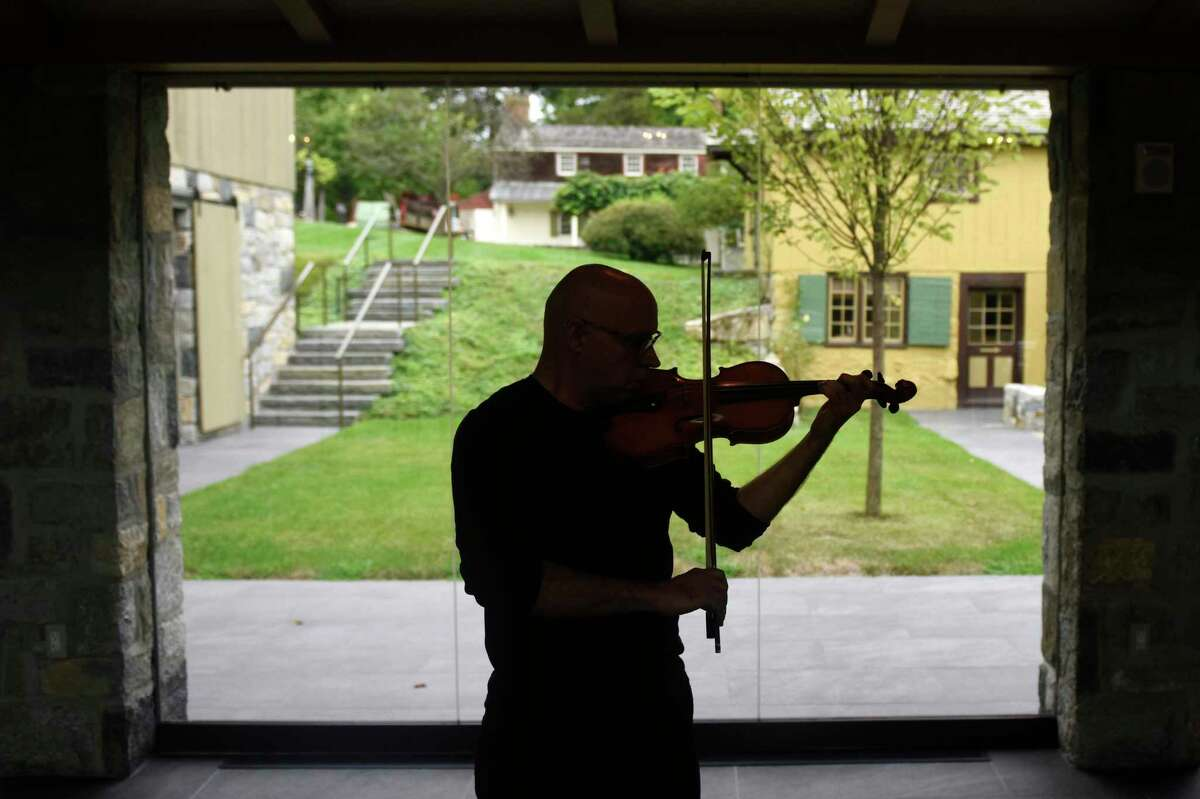 Violinist Icli Zitella plays his instrument at the Greenwich Historical Society in the Cos Cob section of Greenwich, Conn. Wednesday, Sept. 4, 2019. Icli, a Greenwich resident, is part of an upcoming exhibit at the historical society about settling in Fairfield County as an immigrant. He came to the U.S. from Venezuela in 2012 to obtain his Master's at the Manhattan School of Music on a special Visa given to individuals who demonstrate an extraordinary ability in their field.