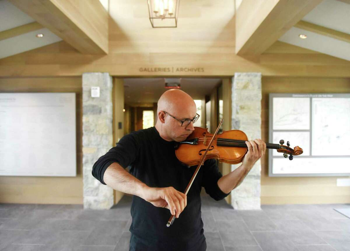 """This is the last weekend to see the Greenwich Historical Society's exhibition on the immigrant experience called """"An American Story: Finding Home in Fairfield County."""" It runs through Monday. It tells the stories of grit and resilience of immigrants and refugees, including violinist Icli Zitella, who He came to the U.S. from Venezuela in 2012 on a special visa to study music."""