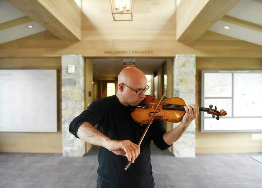 "This is the last weekend to see the Greenwich Historical Society's exhibition on the immigrant experience called ""An American Story: Finding Home in Fairfield County."" It runs through Monday. It tells the stories of grit and resilience of immigrants and refugees, including violinist Icli Zitella, who He came to the U.S. from Venezuela in 2012 on a special visa to study music. Photo: File / Tyler Sizemore / Hearst Connecticut Media / Greenwich Time"
