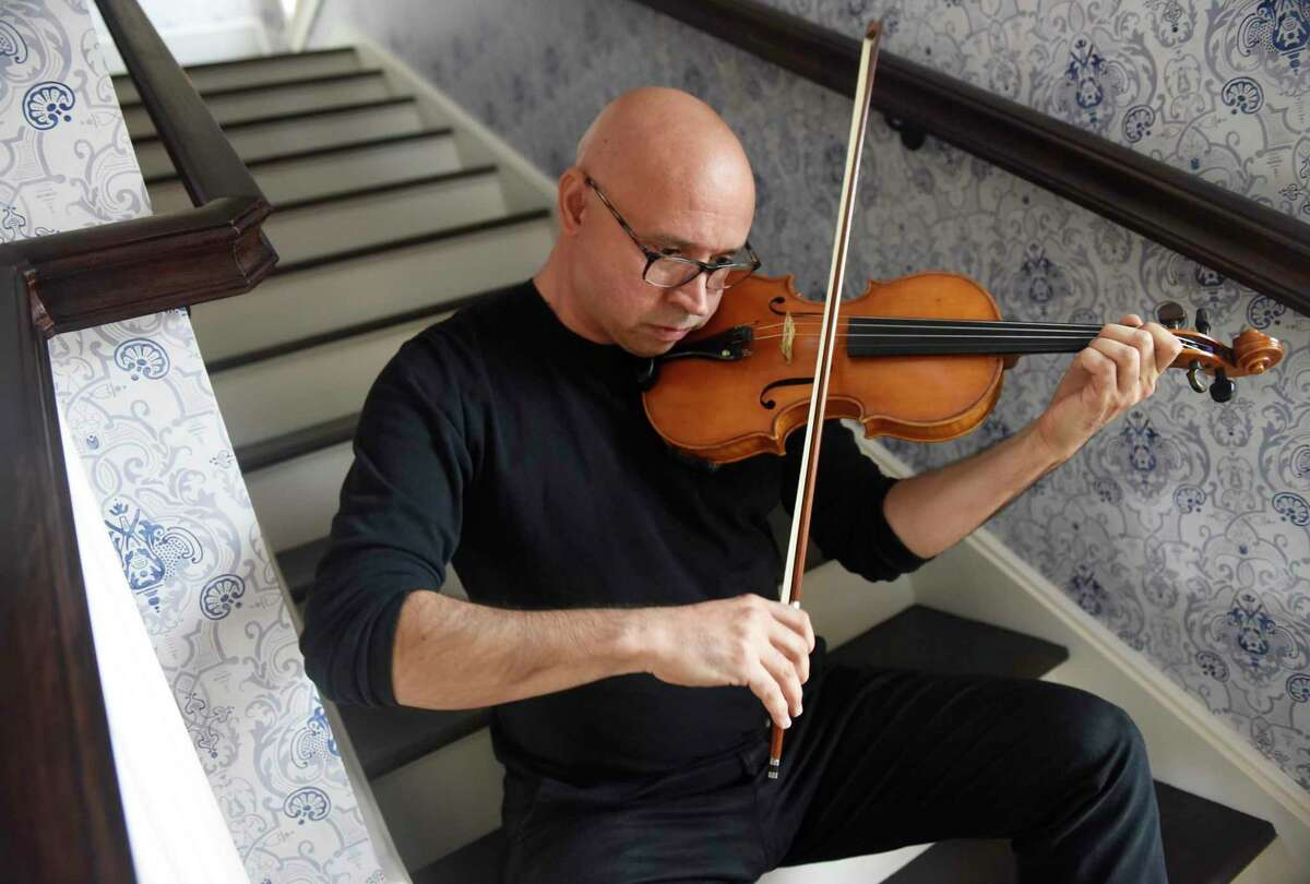 Musician Icli Zitella plays his violin at the Greenwich Historical Society in Cos Cob. Icli, a Greenwich resident, is part of an exhibit at the historical society about settling in Fairfield County as an immigrant. The show, called