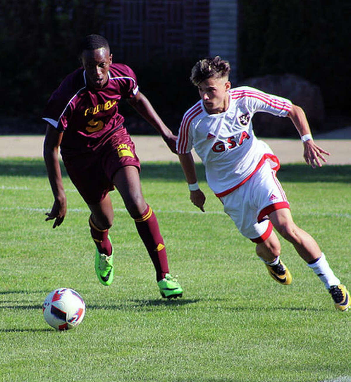 A Gateway Legacy Christian Academy player, right, moves the ball during a game last season.