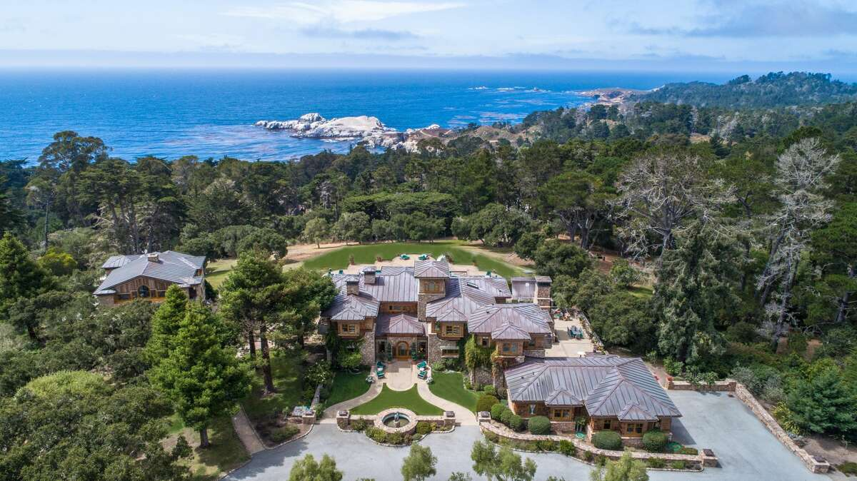 A Carmel Highlands estate with eight bedrooms and 10 bathrooms is set on a private 14-acre knoll overlooking the Pacific and Point Lobos.