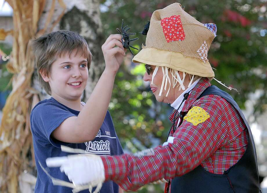 ANSONIA-HARVEST FESTIVAL-PHOTO/JEFF HOLT-JH00177C 10/7/06-12 year old Amar Lapastica of Seymour participated in the storytelling of Southbury storyteller Joyce Marie Rayno during the city's 3rd Annual Harvest Festival which featured vendors and food, games and storytelling. (Photo/Jeff Holt)