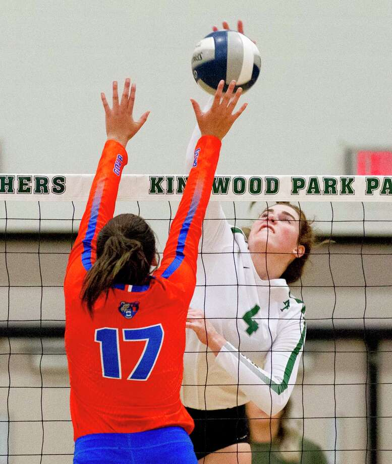 Kingwood Park outside hitter Elizabeth Overmyer (4) gets a shot past Grand Oaks right side hitter Emma Soniat (17) during the first set of a District 20-5A high school volleyball match at Kingwood Park High School, Tuesday, Sept. 10, 2019, in Kingwood. Photo: Jason Fochtman, Houston Chronicle / Staff Photographer / Houston Chronicle