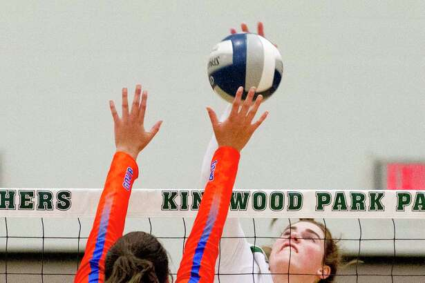 Kingwood Park outside hitter Elizabeth Overmyer (4) gets a shot past Grand Oaks right side hitter Emma Soniat (17) during the first set of a District 20-5A high school volleyball match at Kingwood Park High School, Tuesday, Sept. 10, 2019, in Kingwood.