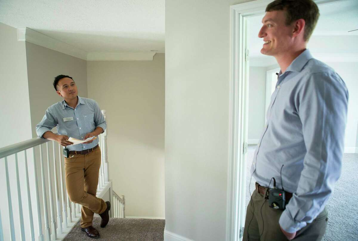 Home appraiser Mike Taylor (right), who grew up in the neighborhood, and Ace Tejada, a real estate agent who has lived in the neighborhood for a year, look at a home for sale in the Wimbledon Champions neighborhood in Spring, Monday, Sept. 16, 2019. Several homes in the area have been purchased by investors after Harvey and are in various states of repair from fully remodeled to currently in foreclosure.