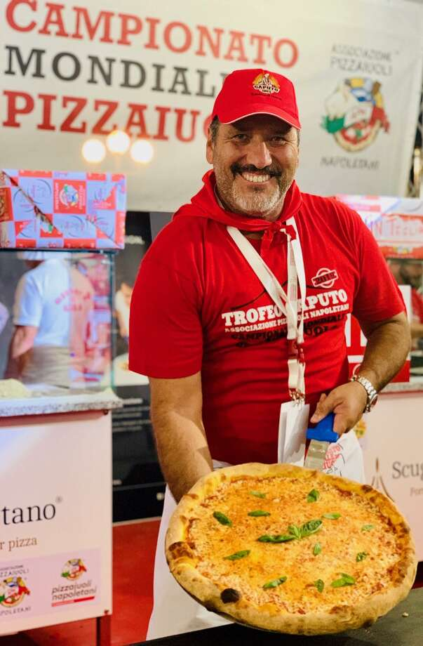 Just landing from Naples, Italy, RC Gallegos is grinning ear to ear with news that he is #8 in the World after sharing his award-winning plain cheese pie in Naples, Italy at The Caputo Cup, Pizzaiolo World Championship. A dream come true for the US Pizza Team member. Photo: Courtesy Photo