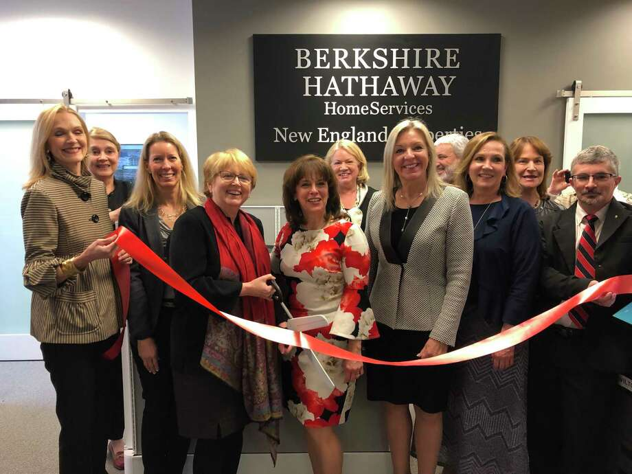 Berkshire Hathaway HomeServices New England Properties was named a top workplace in a competition sponsored by Hearst Connecticut Media. At the ribbon cutting for the brokerage's new office in Wilton Center on April 9, 2019, are, from left, Dianne deWitt, Emmary Carlson, Kim Burke, First Selectwoman Lynne Vanderslice, Office Leader Jo Simko, Lynn Schneider, president and CEO Candace Adams, Dan Ianniello, Regional Manager Brenda Maher, Mary Ellen Williams, Dee Shoals and Sidney Almeida. Photo: Contributed Photo / Wilton Chamber Of Commerce / Wilton Bulletin