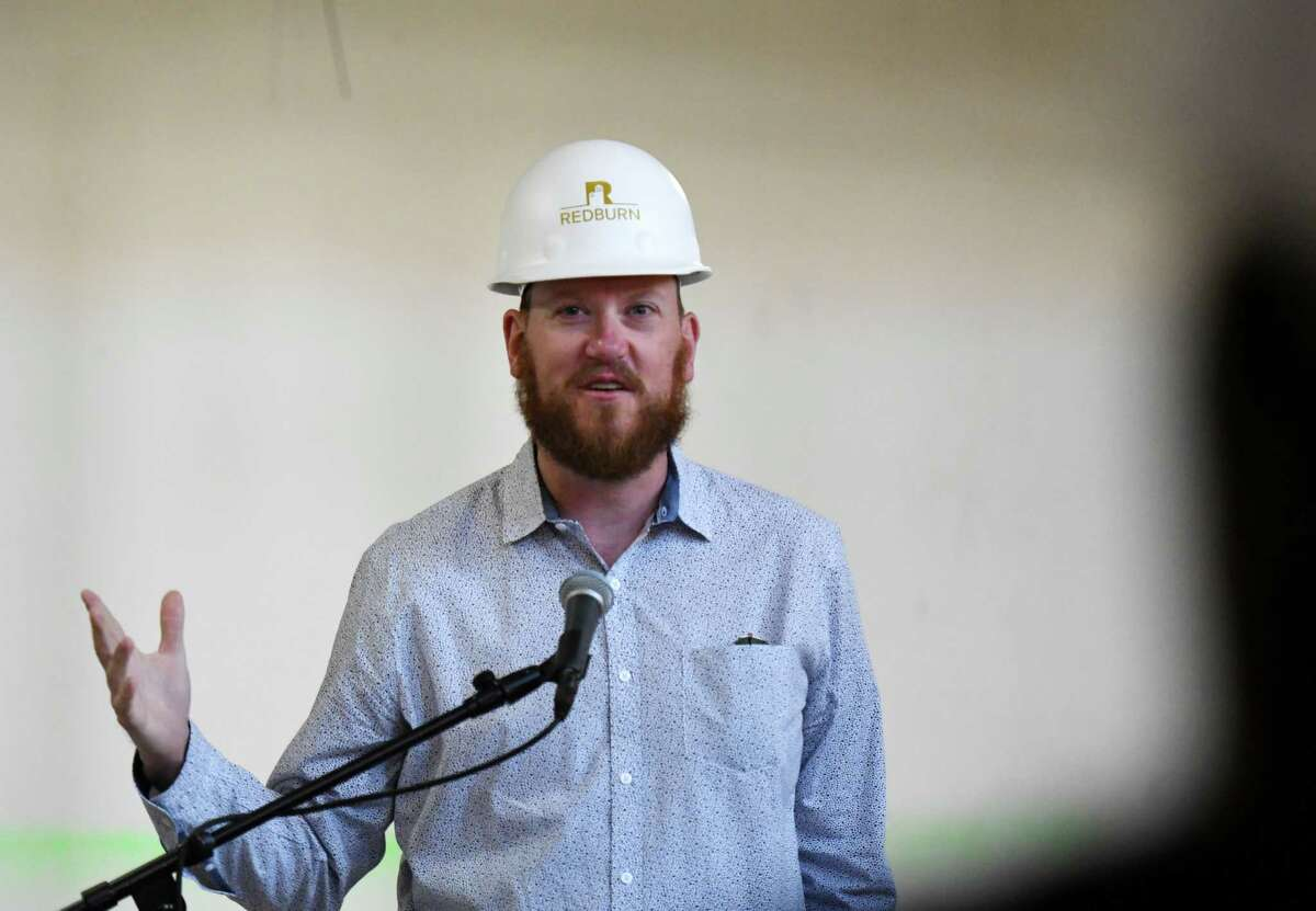 Jeff Buell, principal of Redburn Development, speaks during a 2019 media event at the Kenmore building, part of Redburn's $80 million redevelopment of multiple historic buildings in the North Pearl Street corridor in downtown Albany. Redburn is suing Blue lounge, a tenant in another of its nearby buildings. (Will Waldron/Times Union)