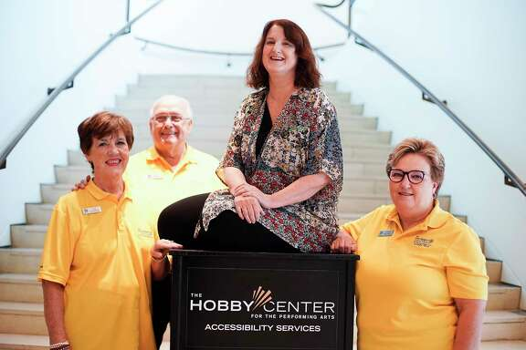 Judi Stallings, director of education and community engagement for the Hobby Center, stands with volunteers Kay and Joe Kane, from left, and Debbie Tellez, on Thursday, Aug. 29, 2019 in Houston.