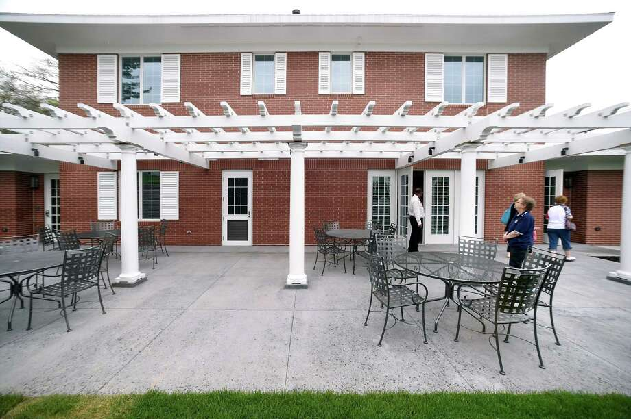People view the back patio of the VA Connecticut Fisher House on the grounds of the West Haven Campus of the VA Connecticut Healthcare System after the dedication on May 4, 2018. Photo: Arnold Gold / New Haven Register / New Haven Register