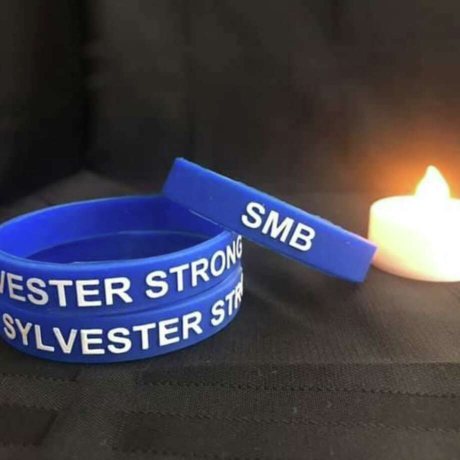 """Bristol-based McLellan Tree Service made """"Sylvester Strong"""" bracelets in honor of Steven Sylvester, an employee of the company killed in a March 25, 2019 crash in Orange. Photo: /"""
