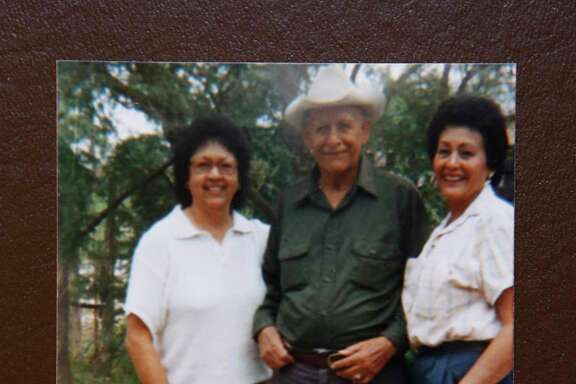 Copy photo of Juan Flores Bonilla (center), father of Paula Flores Smith, Arlinda Flores Burgess (left), sister of Paula Flores Smith, and Paula Flores Smith (right). Photo provided by Paula Flores Smith, 86, granddaughter of Longino Flores, who was one of 15 men killed at the Porvenir massacre a century ago, at her home in Arlington, Texas on Monday, September 23, 2019. A century after U.S. soldiers and Texas Rangers slaughtered 15 unarmed Mexican boys and men at Porvenir, a remote West Texas border settlement, the nearly forgotten event is gaining exposure. For the descendants of the slain, the attention is very welcome and long overdue.