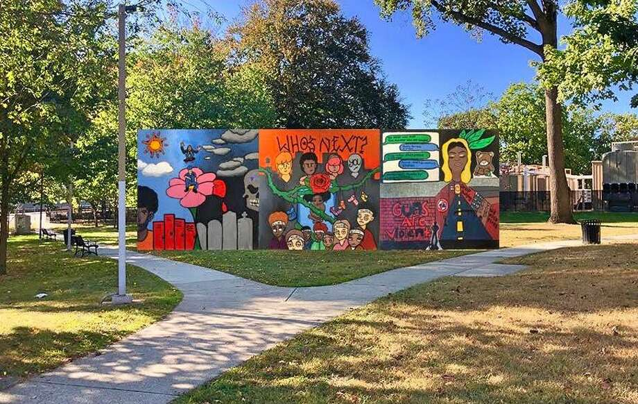 Representatives of the Trumbull Rotary Club are among those sponsoring a teen mural anti-gun violence project at Bridgeport's Wheeler Park. Photo: Contributed
