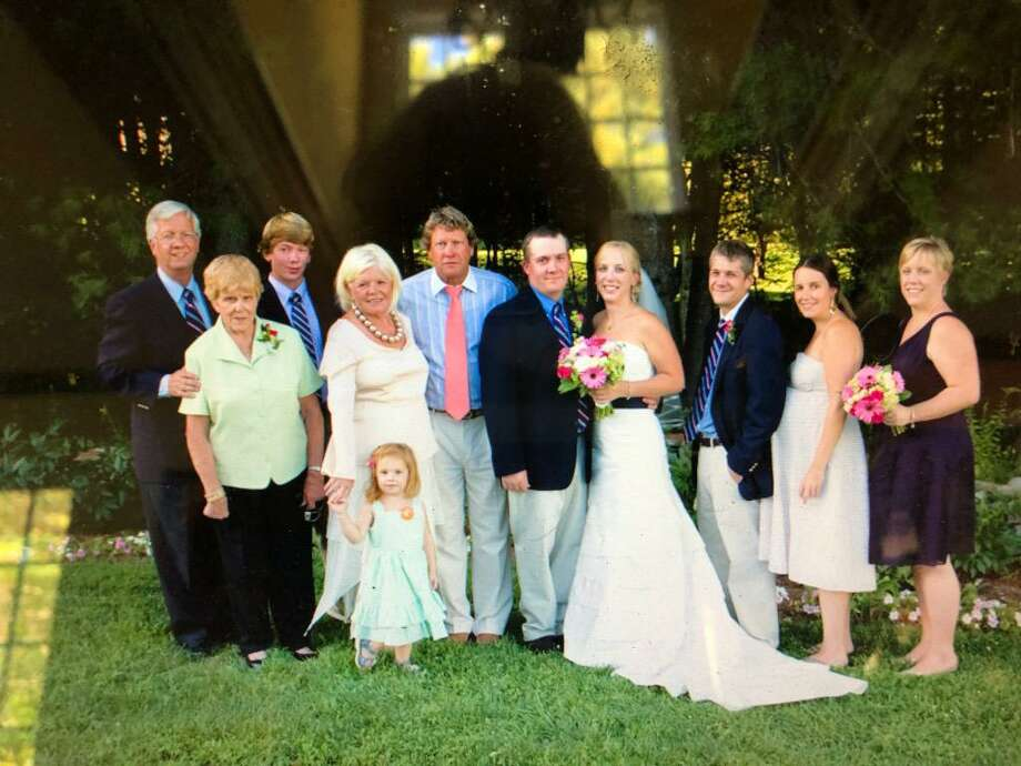 Isabella Mehner, in green short sleeved shirt from a 2010 wedding of her Grandson Warner Manzke. Police say Mehner, 93, was killed in her Cove Road home on Wednesday in Stamford. Photo: Manzke Family / Contributed