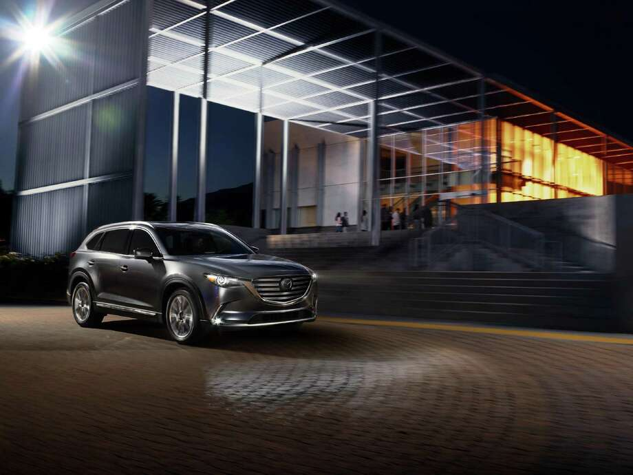 The overall form and futuristic design of the CX-9 displays a sense of dynamic movement, even when it's at a standstill.