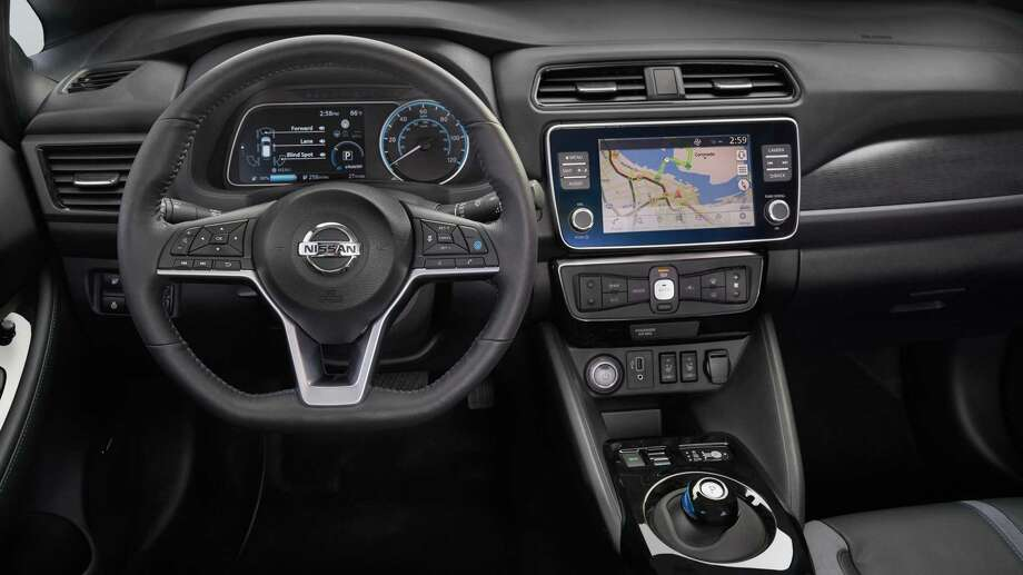 The Leaf's instrument panel provides the driver information where needed, with an analog speedometer and a multi-information display. On the left, a color 7-inch display shows a power gauge by default, while the center touchscreen lets the driver easily operate audio, navigation and smartphone interfaces. Photo: Nissan / © 2019 Nissan