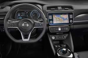 The Leaf's instrument panel provides the driver information where needed, with an analog speedometer and a multi-information display. On the left, a color 7-inch display shows a power gauge by default, while the center touchscreen lets the driver easily operate audio, navigation and smartphone interfaces.