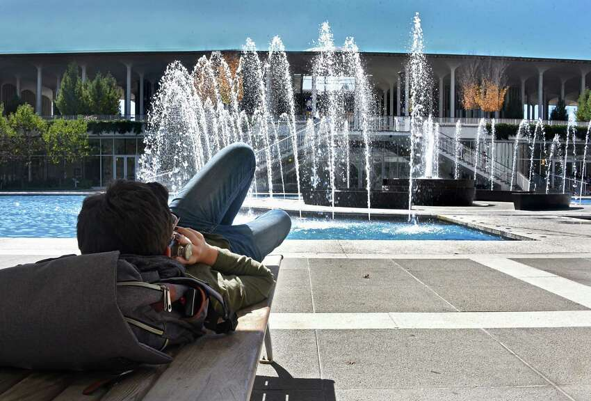 University at Albany Freshman Myah Perino of Catskill talks on the phone as she lays by the fountain in between classes on a beautiful fall day at UAlbany Friday, Sept. 27, 2019 in Albany, N.Y. (Lori Van Buren/Times Union)