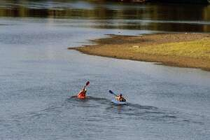 Kayakers paddle up the Mohawk River at Peebles Island State Park on Friday, Sept. 27, 2019, in Cohoes, N.Y. . (Will Waldron/Times Union)
