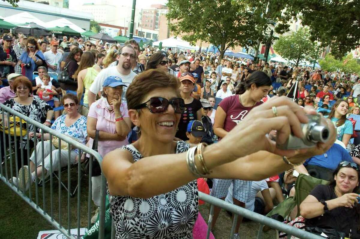 Cathy Iscaro takes photos as The Wanderers perform in Columbus Park for the Alive@Five concert series in Stamford, Conn. on Thursday August 5, 2010.