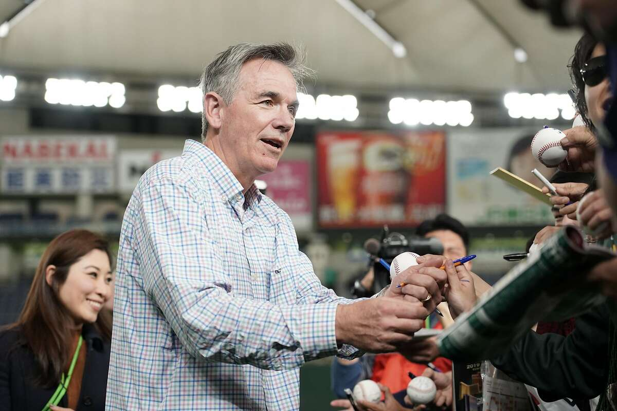 TOKYO, JAPAN - MARCH 18: Oakland Athletics Executive Vice President Billy Beane signs autographs for fans prior to the preseason friendly game between Hokkaido Nippon-Ham Fighters and Oakland Athletics at Tokyo Dome on March 18, 2019 in Tokyo, Japan. (Photo by Masterpress/Getty Images)