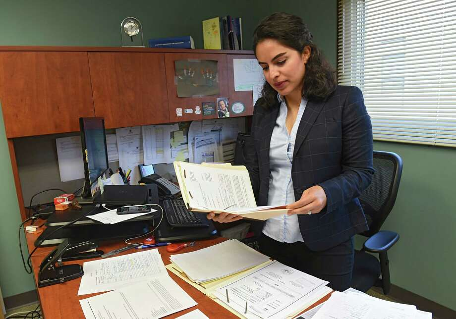 Azin Ahmadi, an immigration attorney, is seen in her office at The Legal Project Office on Friday, Sept. 27, 2019 in Albany, N.Y. Ahmadi runs a program that focuses on providing resources to muslim immigrants who are domestic violence survivors. (Lori Van Buren/Times Union) Photo: Lori Van Buren, Albany Times Union / 40047915A