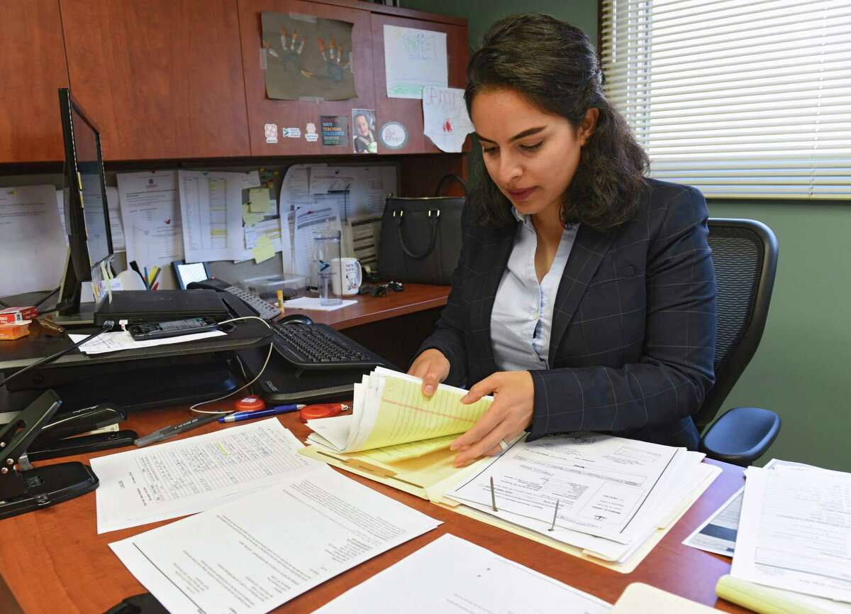 Azin Ahmadi, an immigration attorney, is seen in her office at The Legal Project Office on Friday, Sept. 27, 2019 in Albany, N.Y. Ahmadi runs a program that focuses on providing resources to muslim immigrants who are domestic violence survivors. (Lori Van Buren/Times Union)
