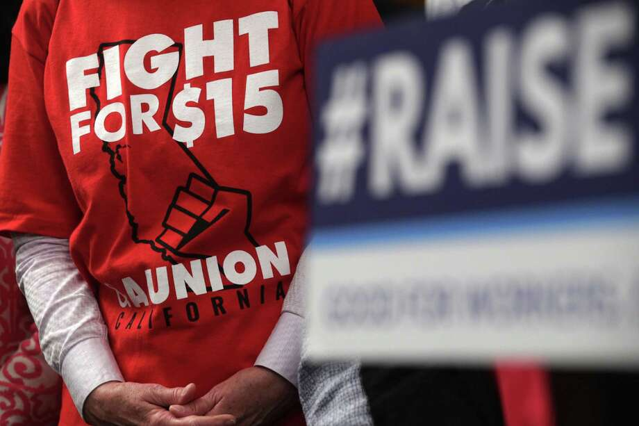 "WASHINGTON, DC - JULY 18: An activist wears a ""Fight For $15"" T-shirt during a news conference prior to a vote on the Raise the Wage Act July 18, 2019 at the U.S. Capitol in Washington, DC. The legislation would raise the federal minimum wage from $7.25 to $15 by 2025. (Photo by Alex Wong/Getty Images) Photo: Alex Wong / Getty Images / 2019 Getty Images"