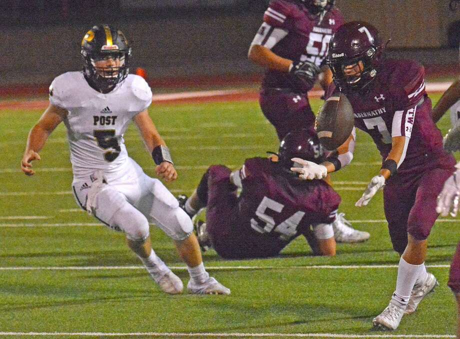 Abernathy's Jake Ayers hauls in a pass as Post defender Slayden Pittman looks on during their non-district football game at Abernathy on Friday. Photo: Nathan Giese/Planview Herald