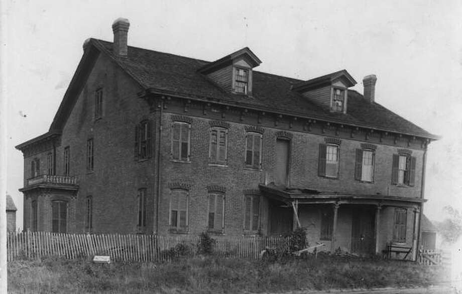 "This a photo of Three Mile House in Edwardsville from 1912. The house, which was built in the 1850s, will be part of the ""Haunted Histories"" presentation on Oct. 16 at Main Street Center as part of Dine & Discover Day. Photo: Madison County Historical Society"