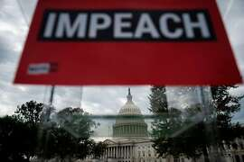 "A sign reading ""impeach"" is seen on a podium in front of the US Capitol building ahead of the ""People's Rally for Impeachment"" on Capitol Hill in Washington, DC on September 26, 2019. (Photo by ANDREW CABALLERO-REYNOLDS / AFP)ANDREW CABALLERO-REYNOLDS/AFP/Getty Images"