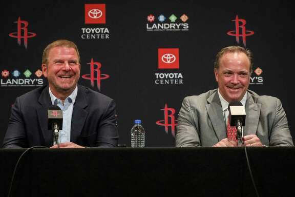 Houston Rockets owner Tilman Fertitta, left, and CEO Tad Brown laugh during a press conference during Houston Rockets Media Day on Friday, Sept. 27, 2019, in Houston.