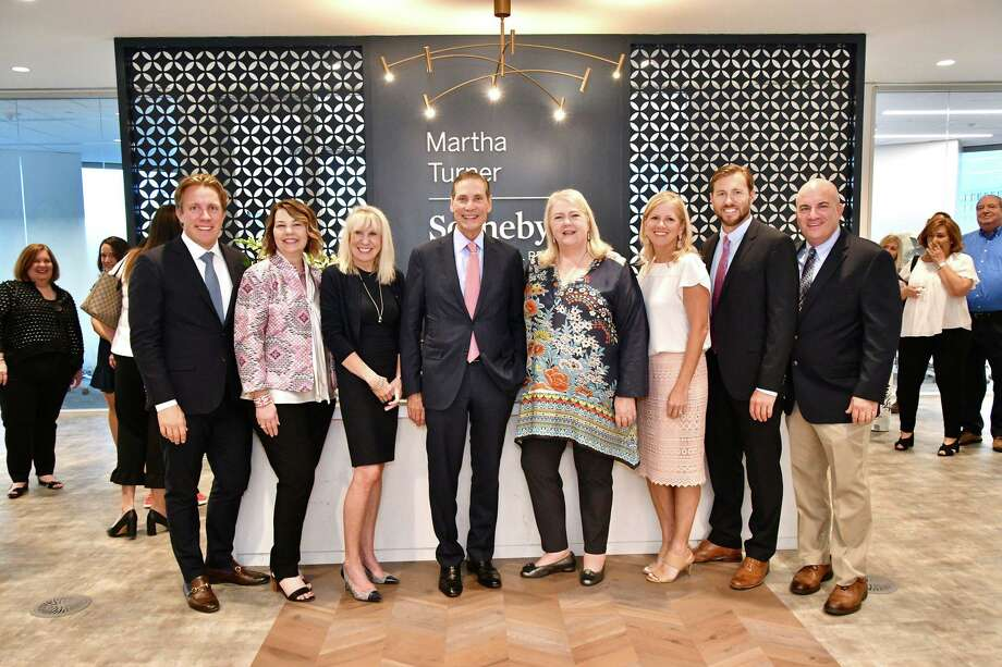 Martha Turner Sotheby's International Realty celebrated the grand opening of the company's new office. In attendance were (l to r) Brad Nelson, Robin Suter, Kathy Korte, Philip White, Marilyn Thompson, Robin Conner, Paul Kilian and Paul Silverman.