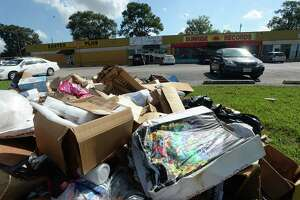 """Debris sits along Eleventh Street outside of Sunrise Rcords, which had 7"""" of flooding from Imelda, destroying many records and other merchandise inside. Photo taken Tuesday, September 24, 2019 Kim Brent/The Enterprise"""