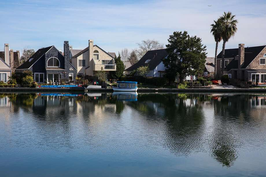 Foster City is surrounded — and protected — by a rocky, uneven seawall. In the years to come, it won't be enough to keep the city from flooding. The City has been working for years to fix the problem. Photo: Gabrielle Lurie / The Chronicle