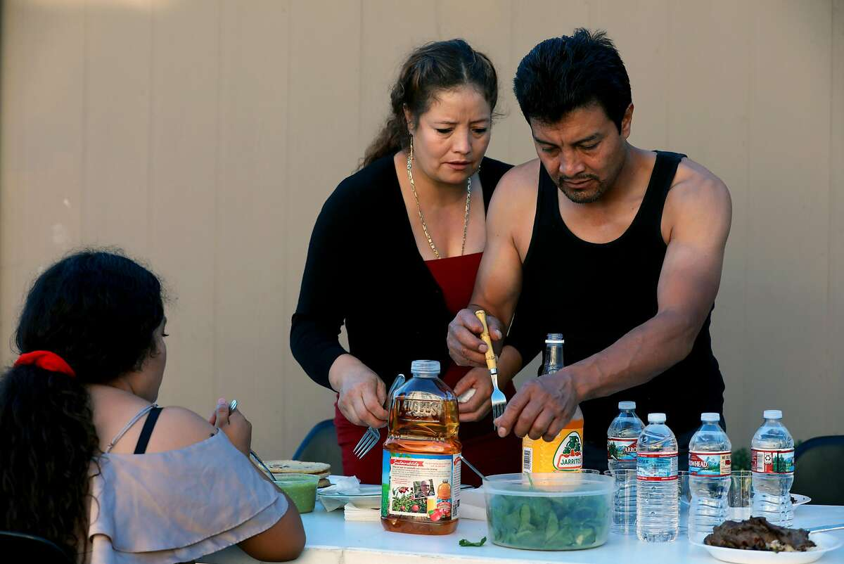 Alexa Lopez, 16, Dianeth Lopez, 39, and Raul Lopez, 47, prepare to have dinner at their home in Richmond, Calif., on Tuesday, September 24, 2019. The elder Lopez is an undocumented immigrant who was detained by ICE for 2 years before being released in February.