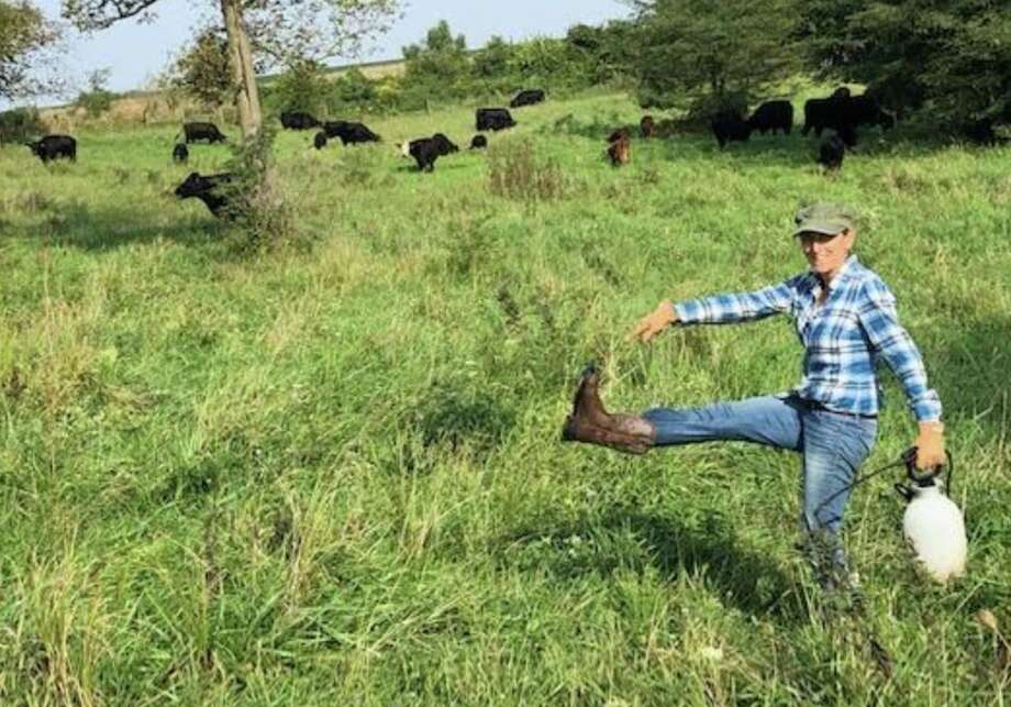 Beth Hoffman shows off some new boots while working on the farm in Iowa. Photo: Beth Hoffman