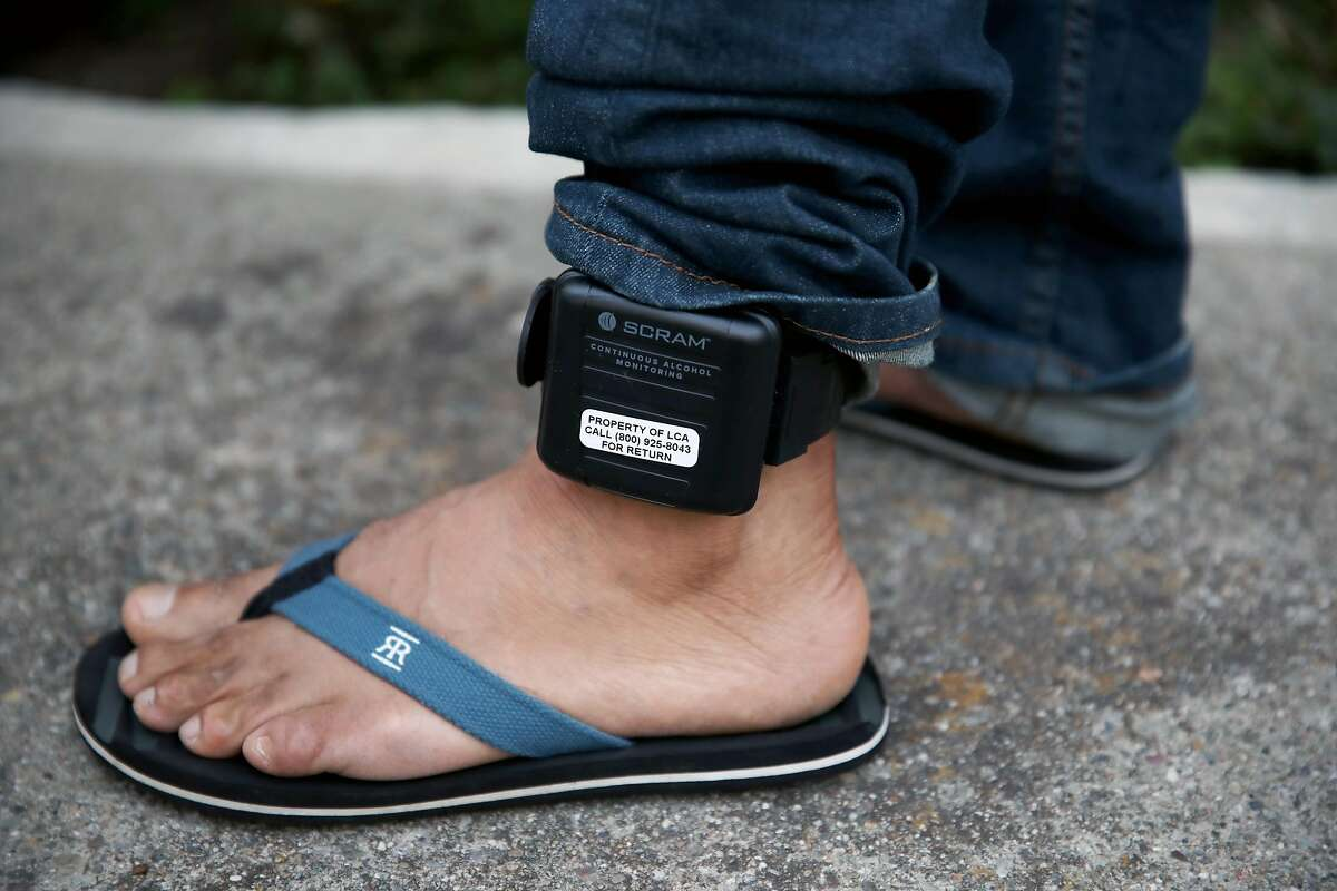 Raul Lopez, 47, wears an ankle monitor as he stands at home in Richmond, Calif., on Tuesday, September 24, 2019. Lopez, originally from Guatemala, is an undocumented immigrant who was detained by ICE for 2 years before being released in February.