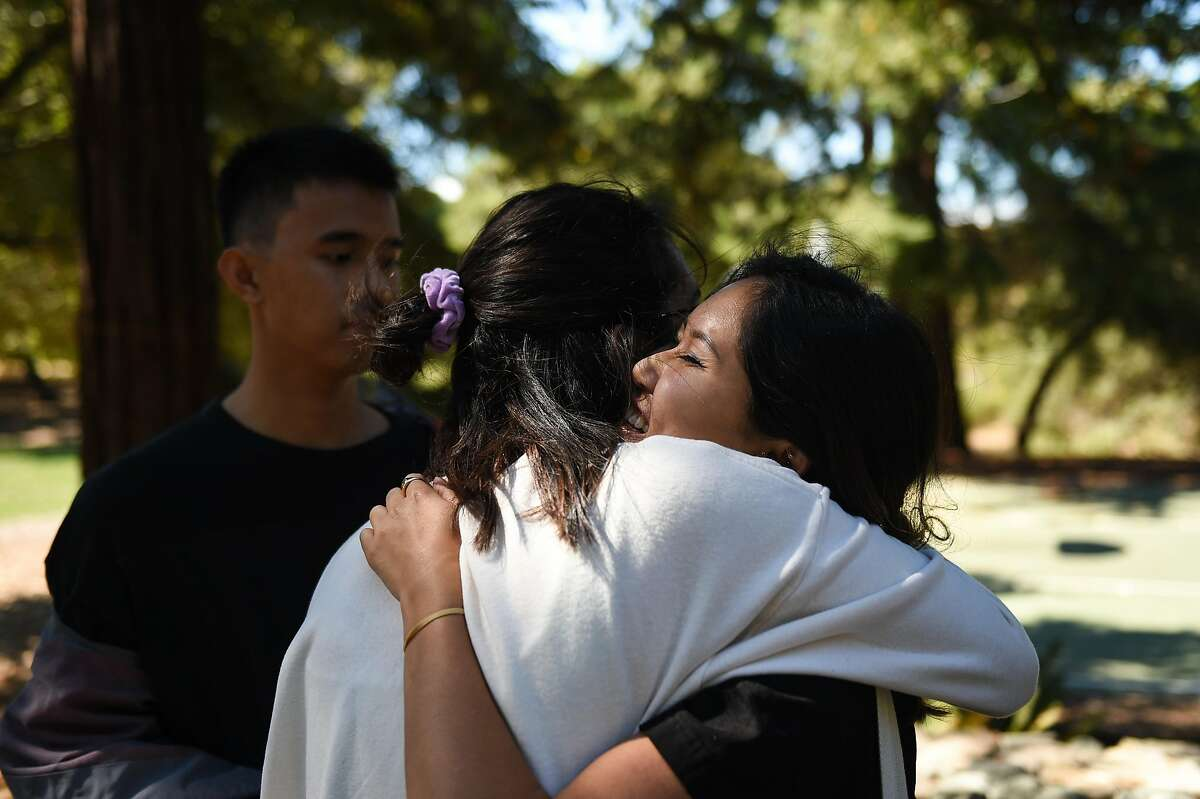 Chanel Kim, right, a product design major from San Diego, hugs fellow Stanford student Isha Kumar, a computer science/art history major from Los Angeles, after taking part in an augmented reality experience near the site of a sexual assault near a student housing complex off Lomita Drive on the campus of Stanford University on Friday September 27, 2019.