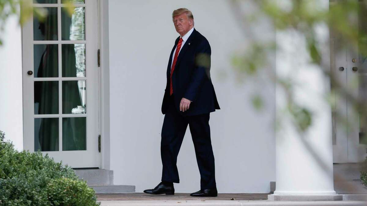 President Donald Trump walks toward the Oval Office of the White House in Washington, Thursday, Sept. 26, 2019, after returning from United Nations General Assembly.